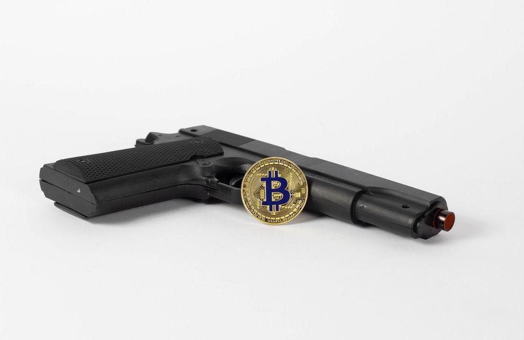 Kryptowährung und Pistole
