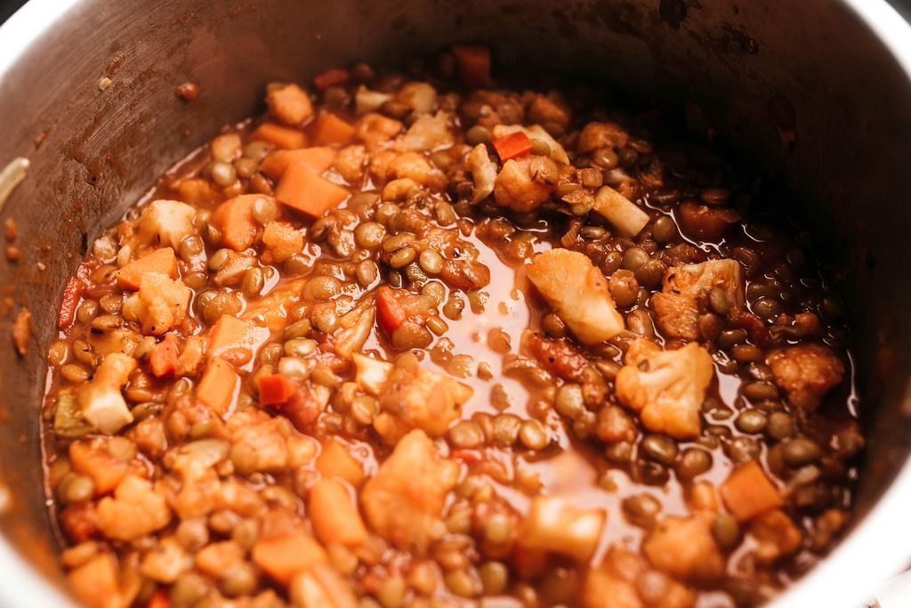 Lentil bolognese sauce with cauliflowers in saucepan