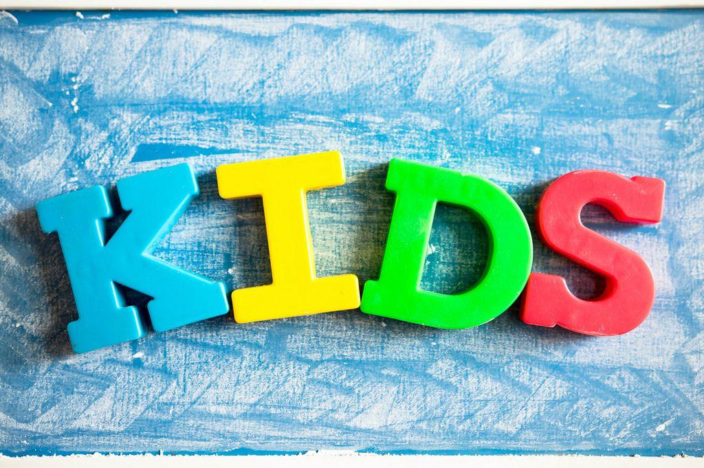 Letter magnets in chalkboard reading KIDS