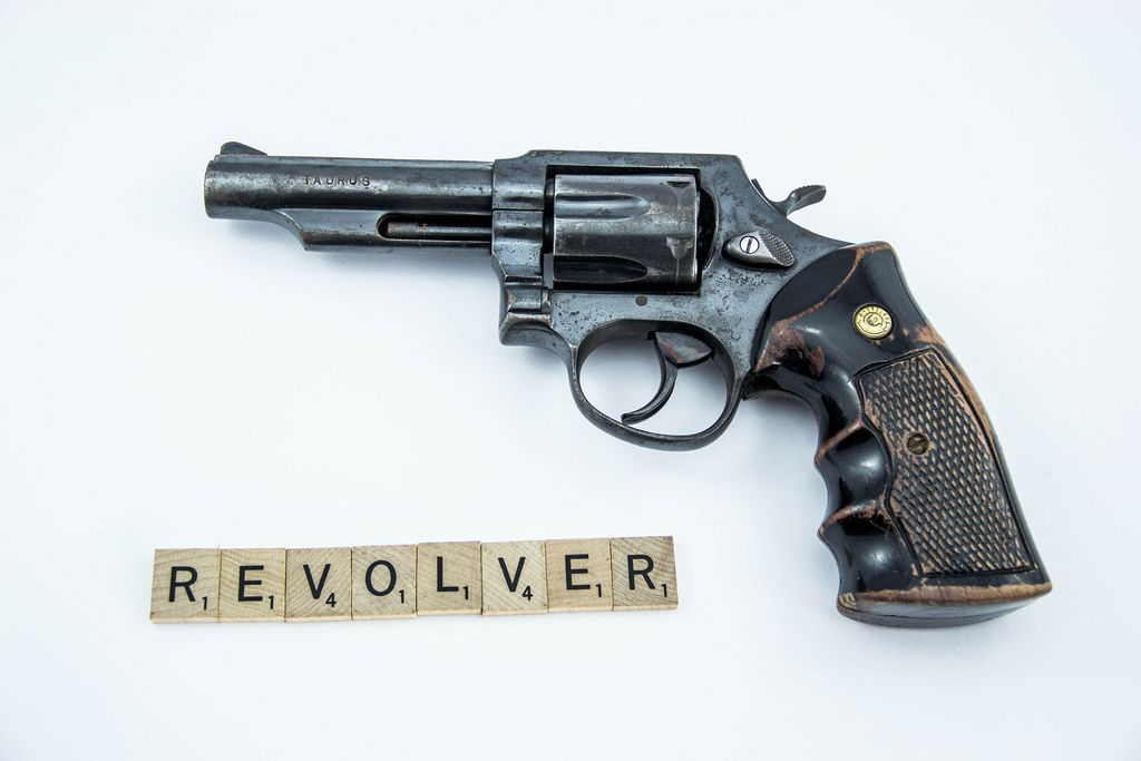 Letters reading REVOLVER