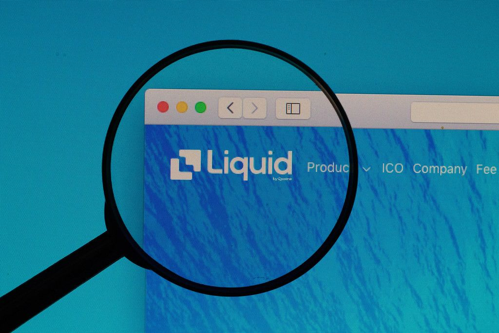 Liquid logo under magnifying glass