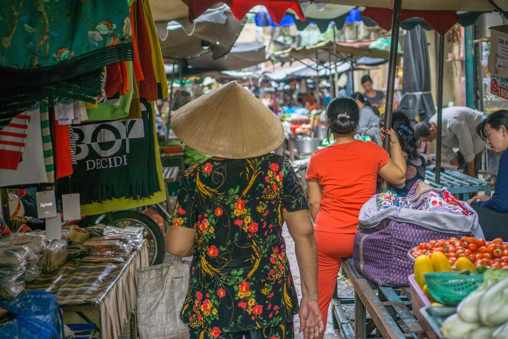 Local Woman walking around a Market in Ho Chi Minh City