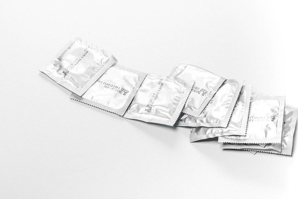 Lot of sealed condoms. The concept of contraception, the fight against AIDS (Flip 2019)
