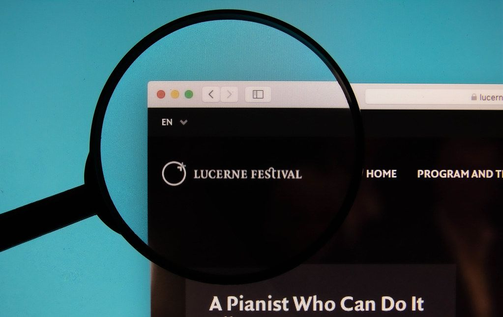 Lucerne Festival logo on a computer screen with a magnifying glass