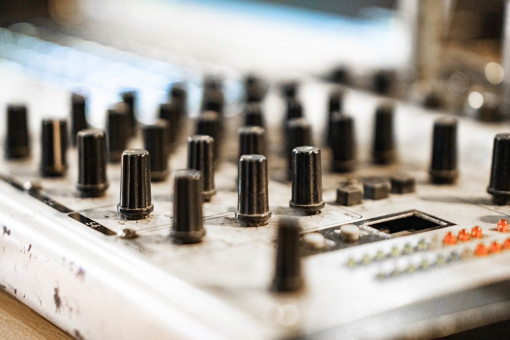 Macro shot of audio mixer knobs