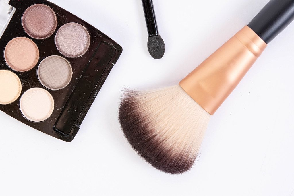 Makeup Brush with makeup set above white background