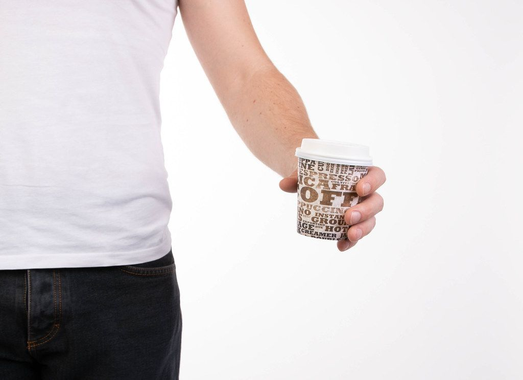 Man holding coffee cup to go