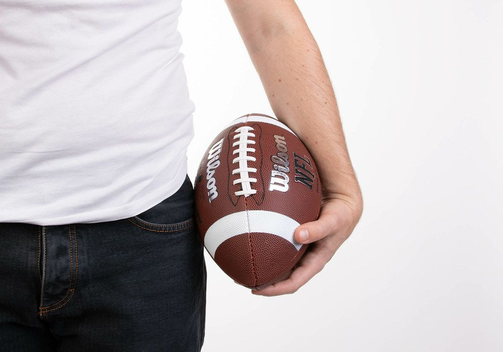 Man holding football ball