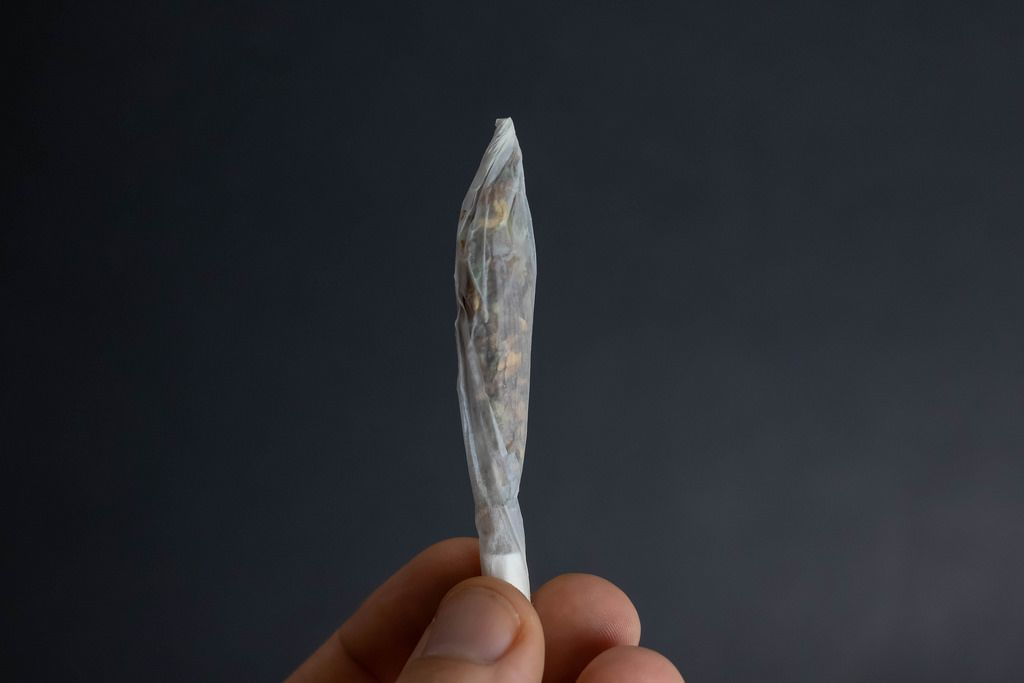 Man holding joint in his hand