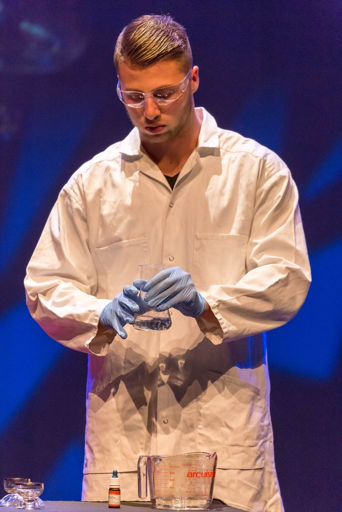 Man in a lab coat working with chemicals - TEDxVenlo 2017