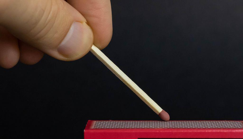 Man lighting a match
