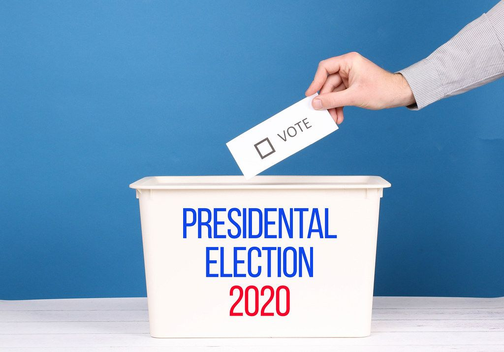 Man putting his vote in the ballot box for Presidental Election 2020.jpg