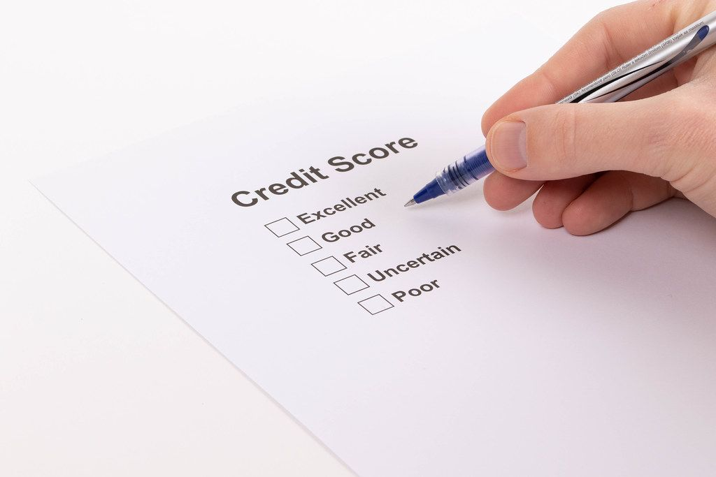 Man selecting credit score result on a document