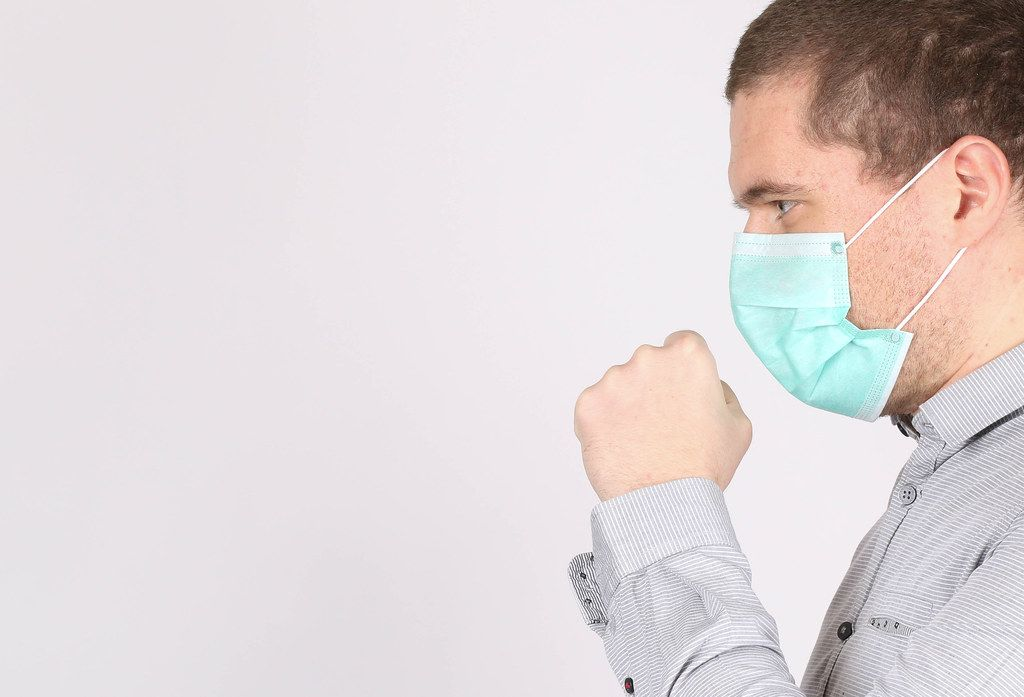 Man suffer from cough with face mask protection