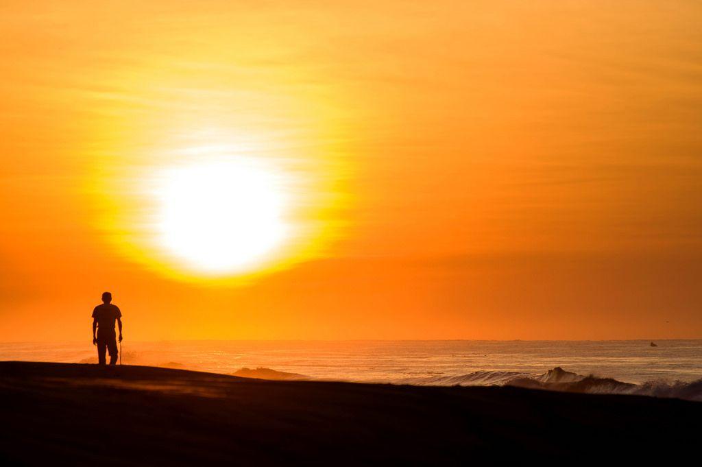 Man watching sunrise