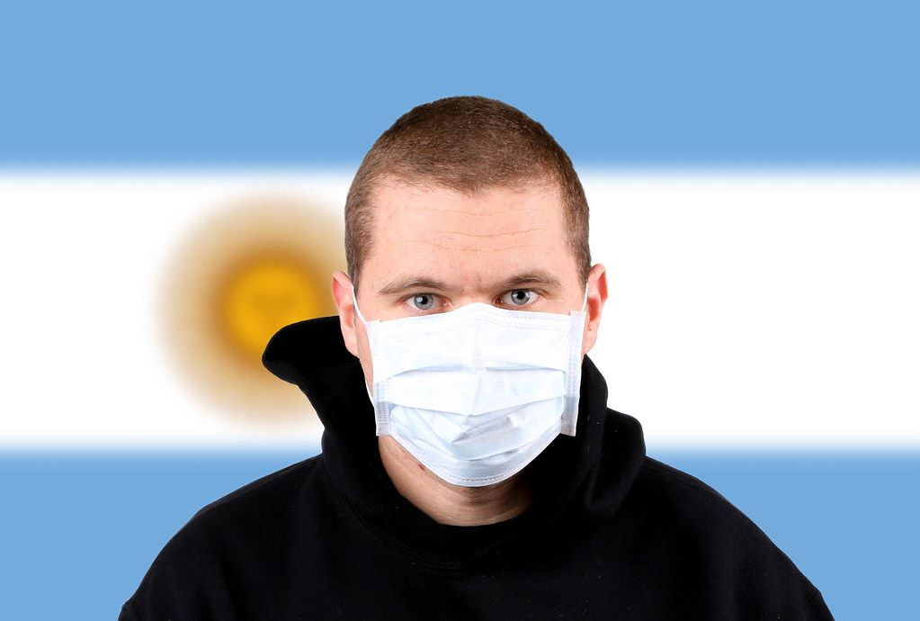 Man wearing protection face mask with flag of Argentina