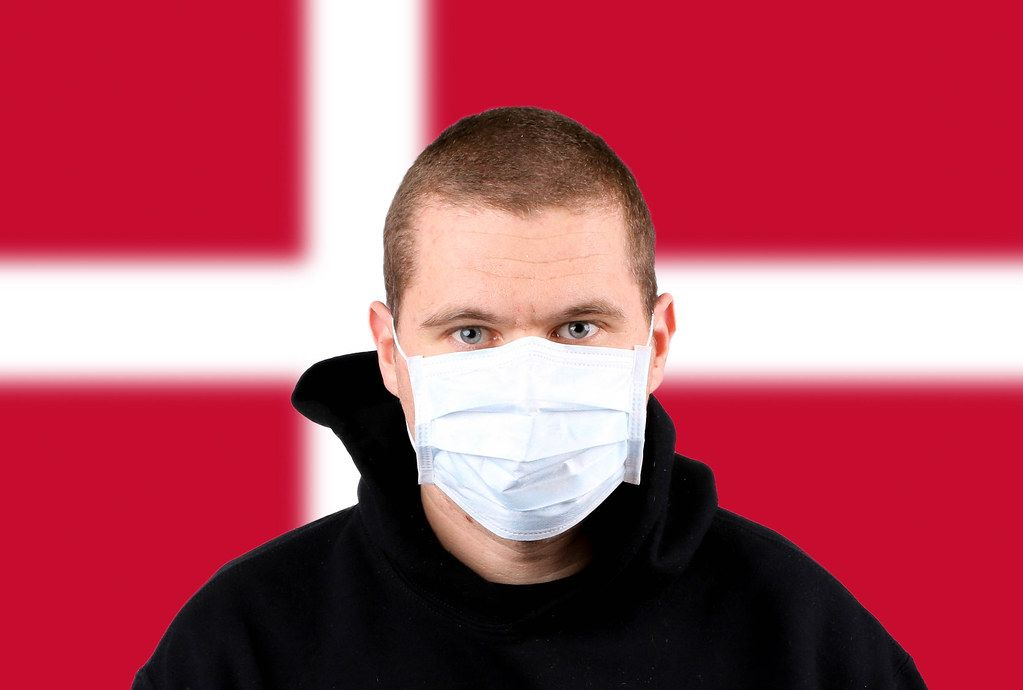 Man wearing protection face mask with flag of Denmark