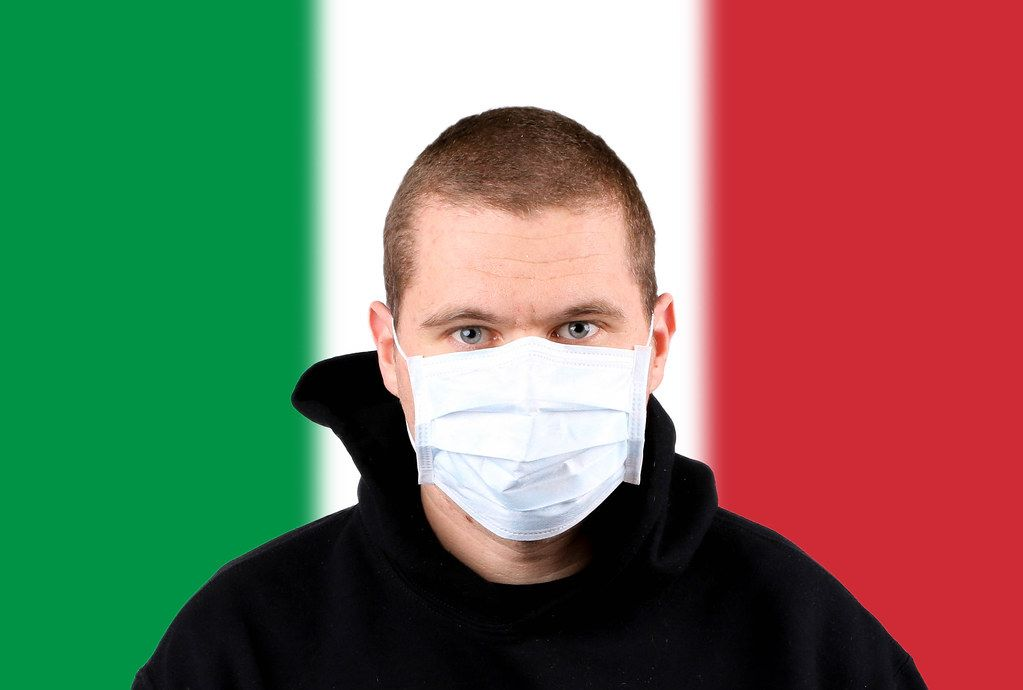 Man wearing protection face mask with flag of Italy