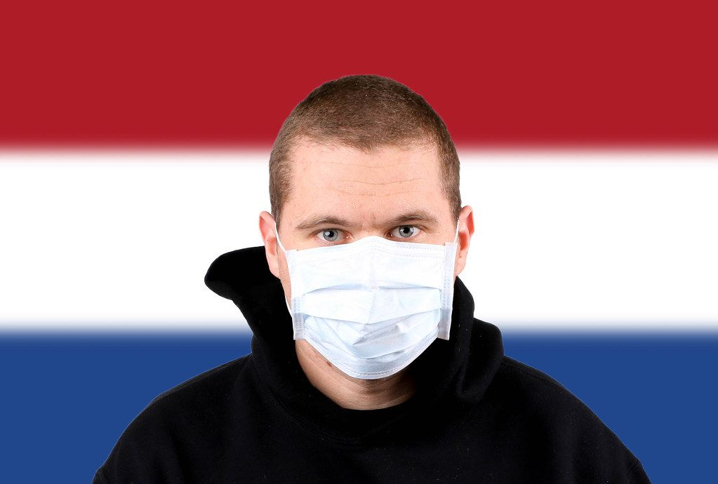 Man wearing protection face mask with flag of Netherlands