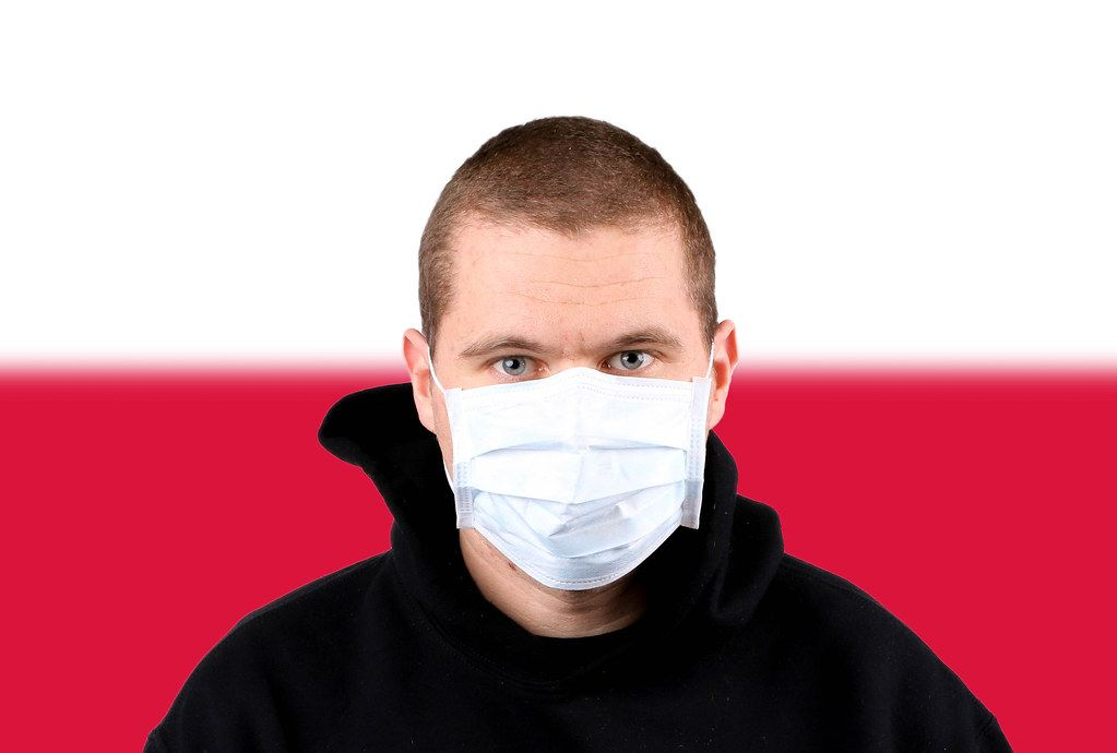 Man wearing protection face mask with flag of Poland