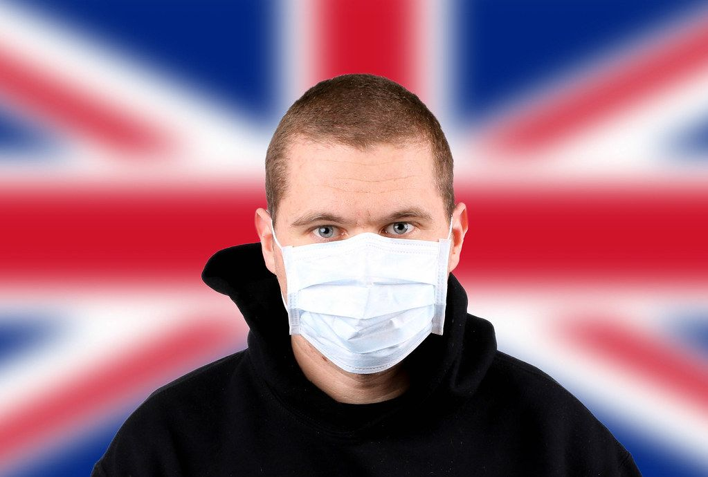 Man wearing protection face mask with flag of United Kingdom