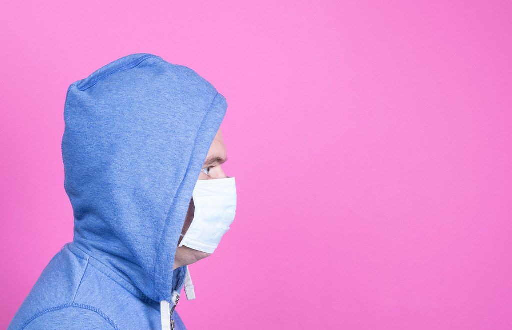 Man with medical flu mask