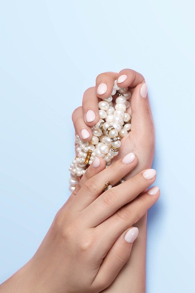 Manicure and beauty concept. Woman showing her beautiful manicure (Flip 2020)