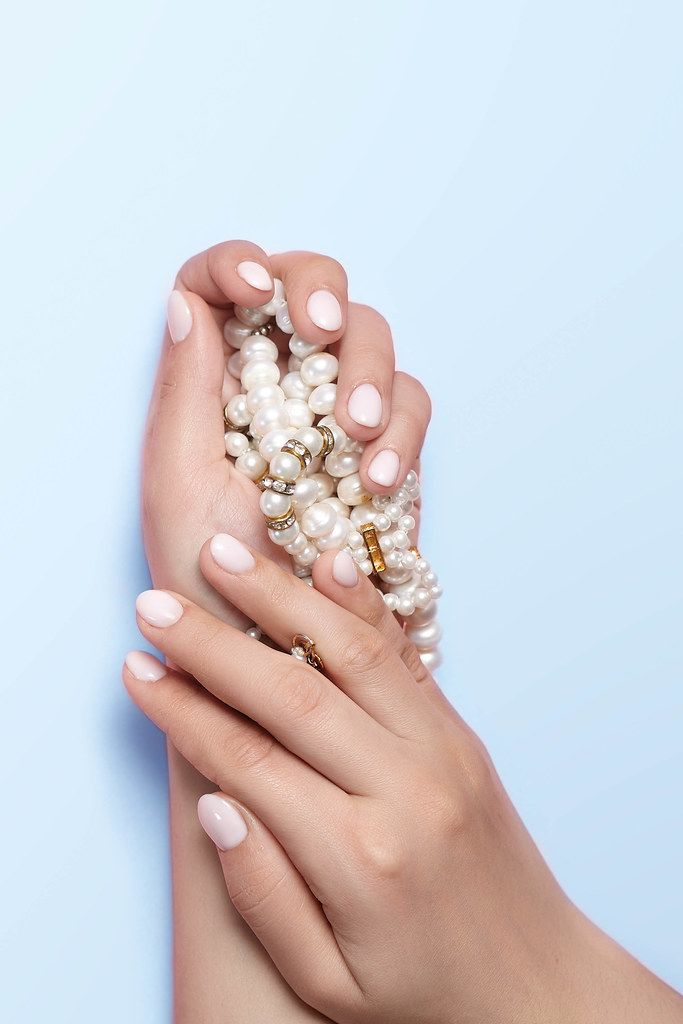Manicure and beauty concept. Woman showing her beautiful manicure