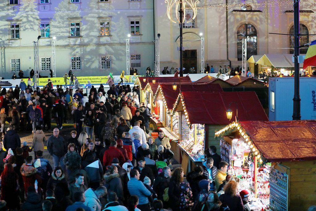 Many tourists at Christmas market fair, Sibiu, Romania (Flip 2019)