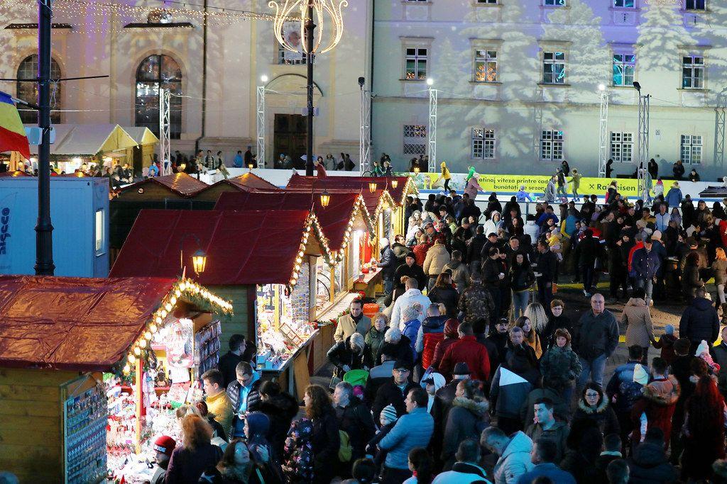Many tourists at Christmas market fair, Sibiu, Romania