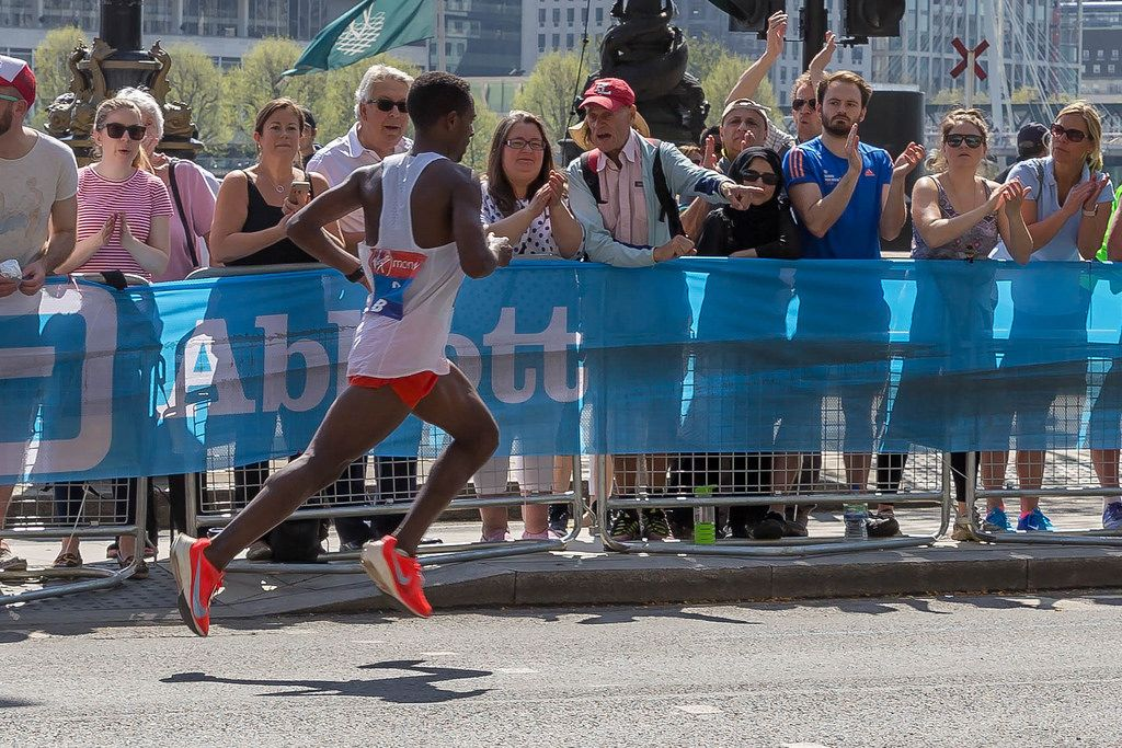 Marathon runner with both feet in the air