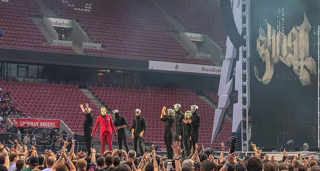 Masked members of the Swedish rock band Ghost, on stage at the RheinEnergie Stadium in Cologne, Germany