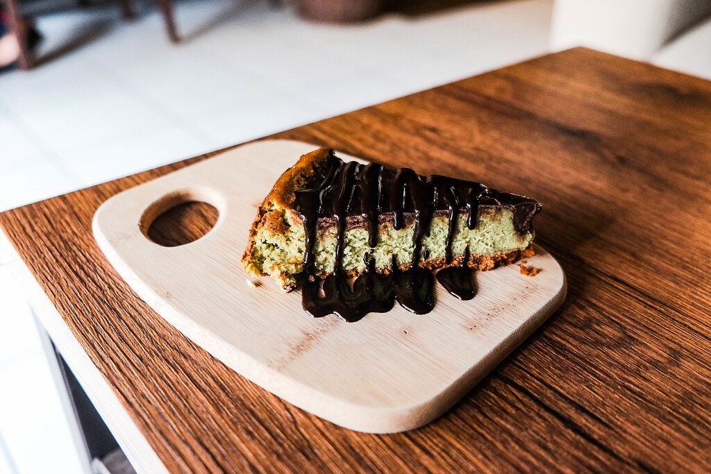 Matcha cheesecake on wooden table