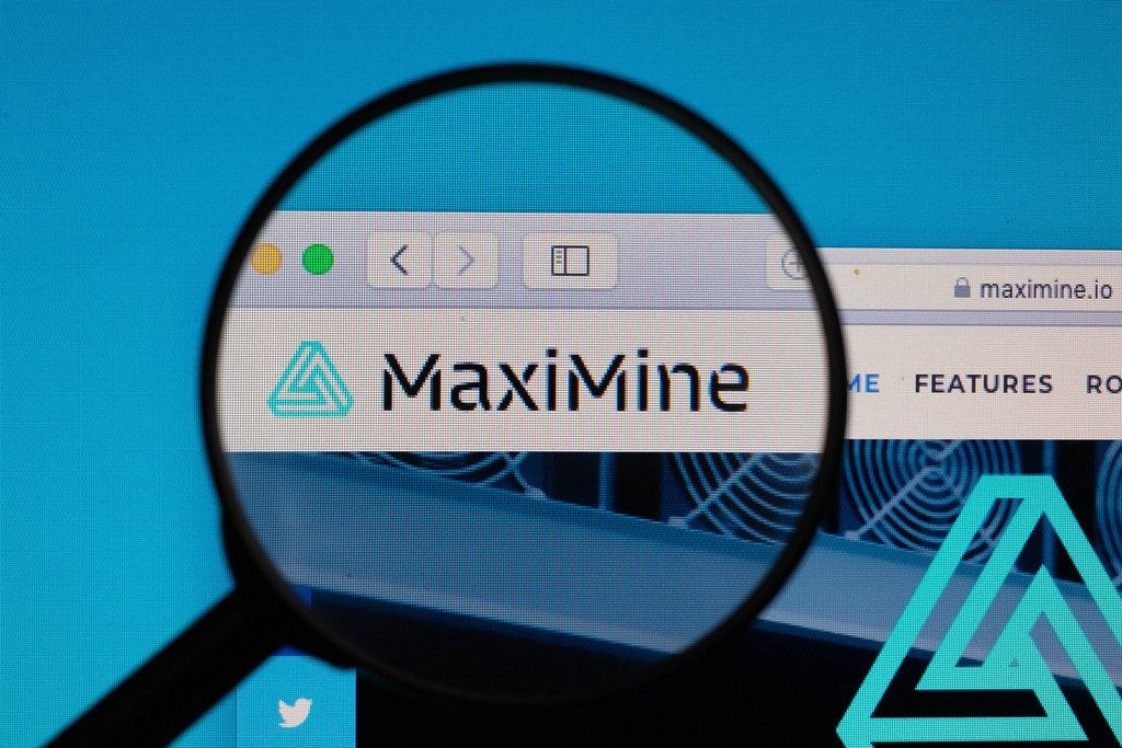 MaxiMine logo under magnifying glass