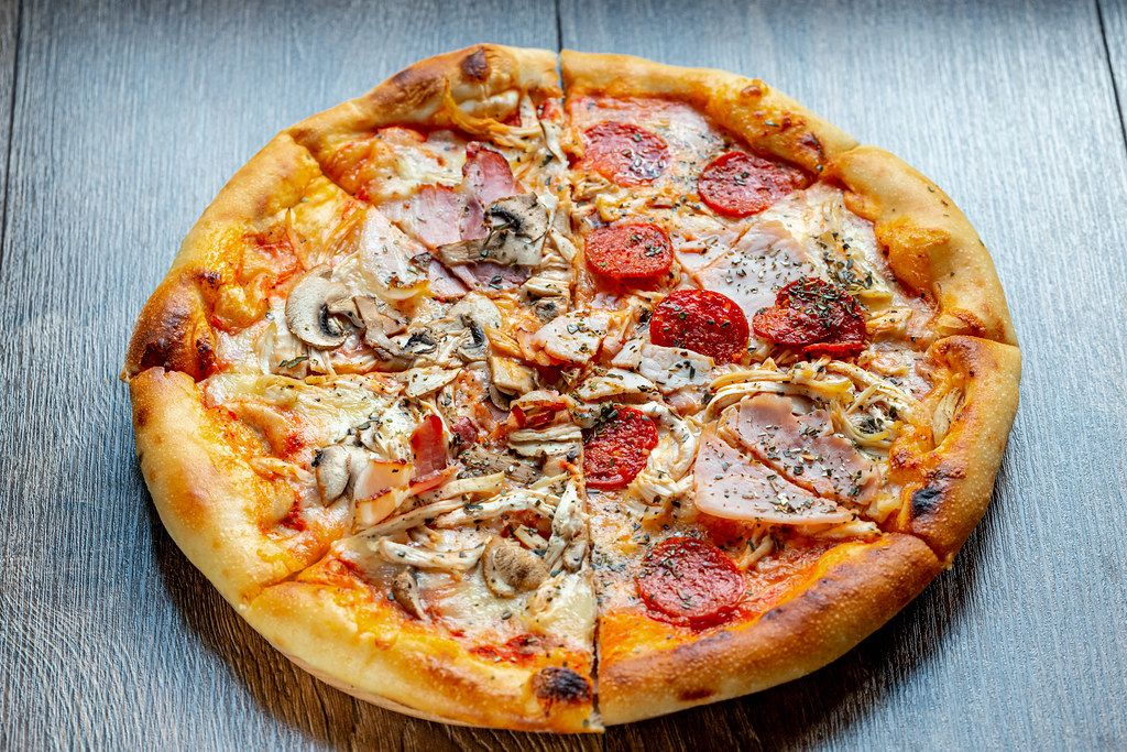 Meat-pizza-with-mushrooms-bacon-chicken-cheese-and-smoked-sausage.jpg