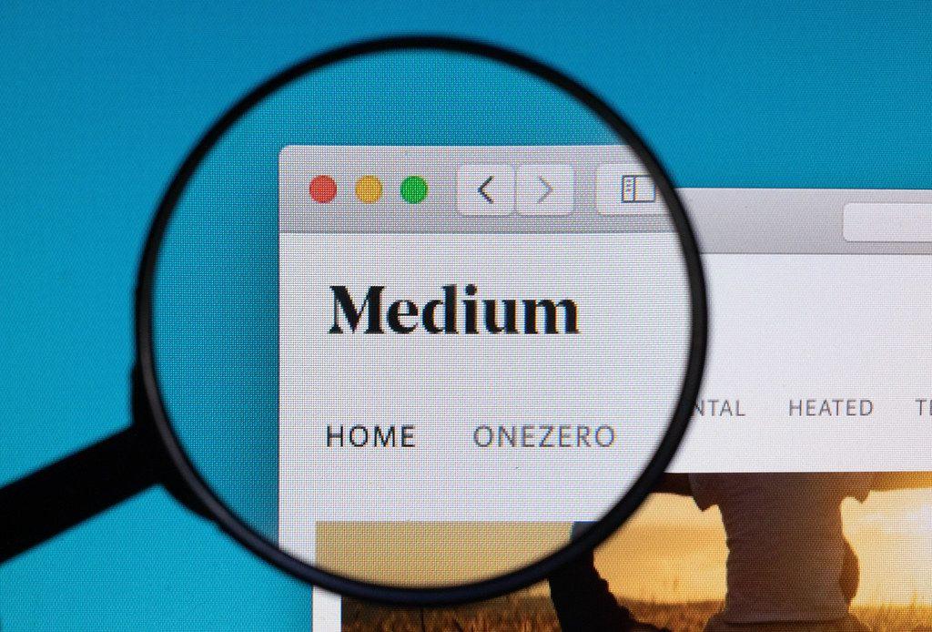 Medium logo under magnifying glass