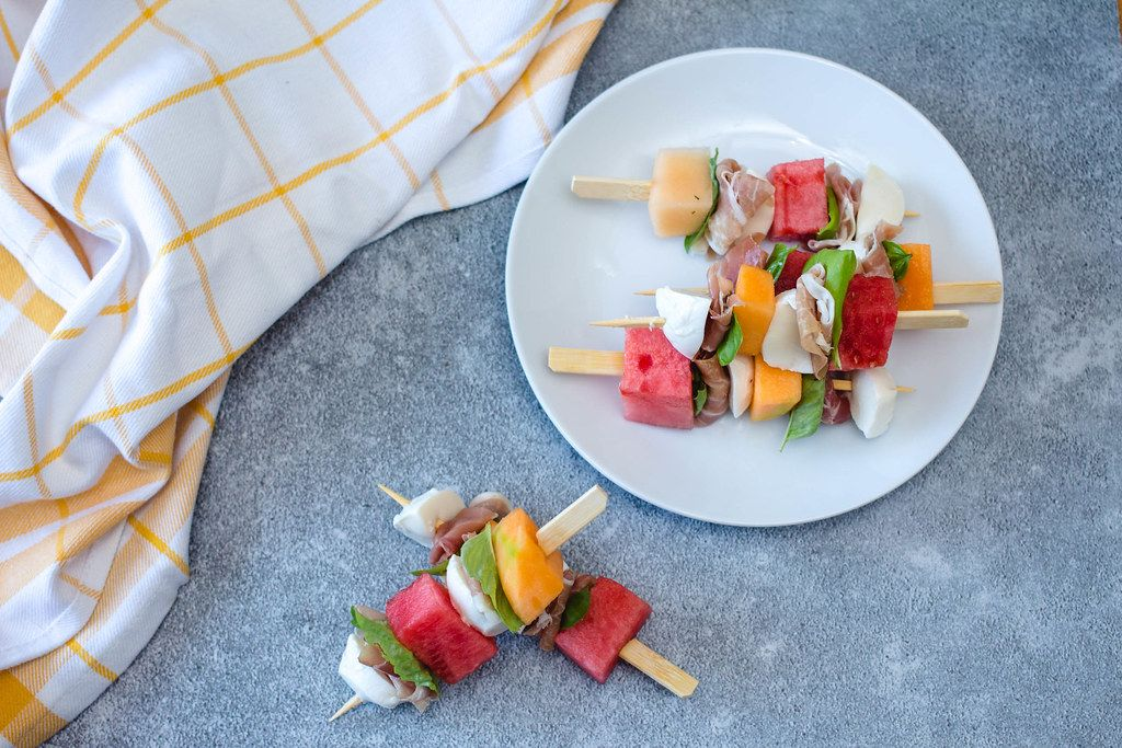 Melon, prosciutto and cheese  skewers top view