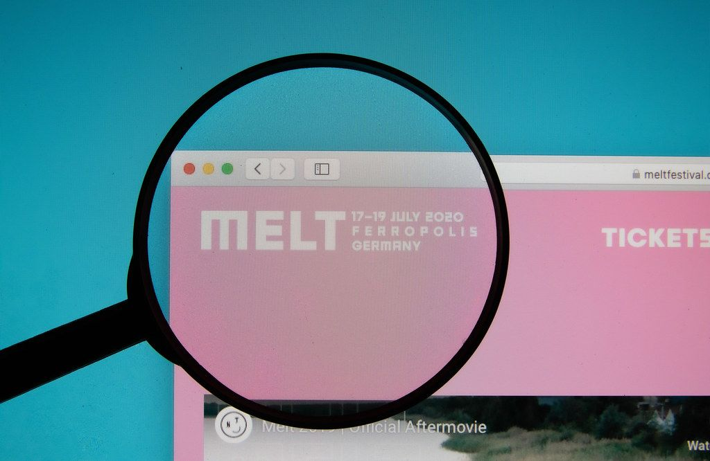 Melt Festival logo on a computer screen with a magnifying glass