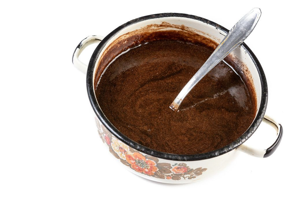 Melted Chocolate in the pot with spoon