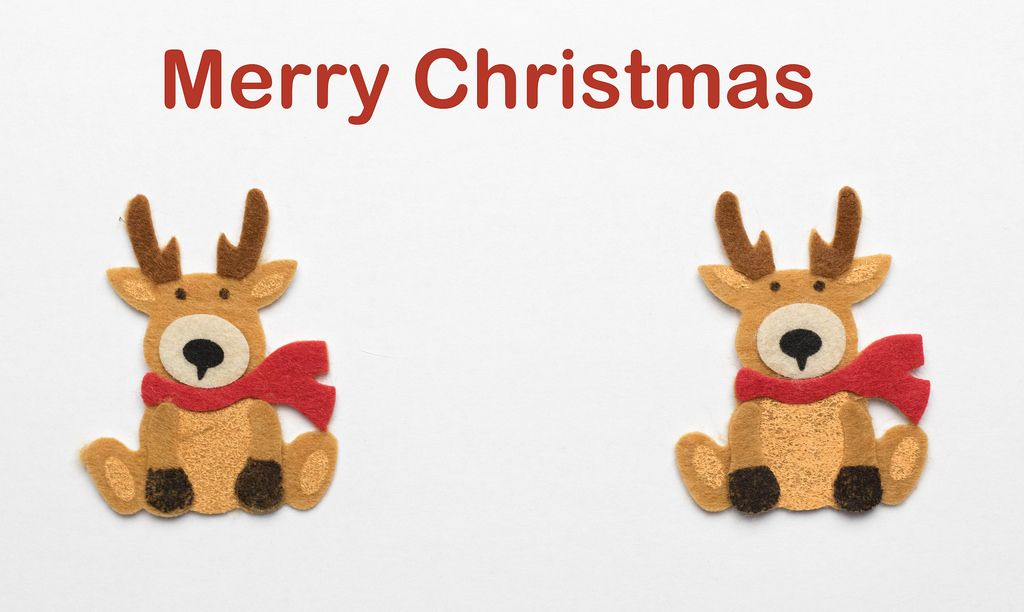 Merry Christmas message with two reindeers