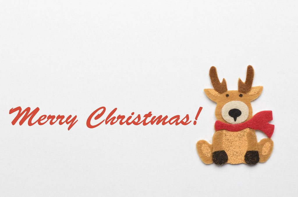 Merry Christmas Schriftzug mit einem Rentier