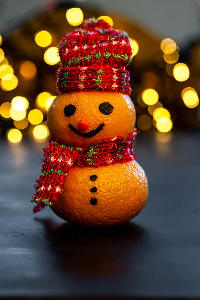 Merry Christmas snowman made from tangerines