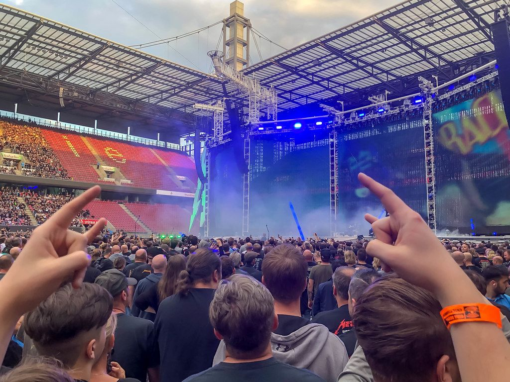 Metal fans at a Metallica concert in the RheinEnergie Stadium in Cologne, during the WorldWired Tour, show the Mano Cornuta