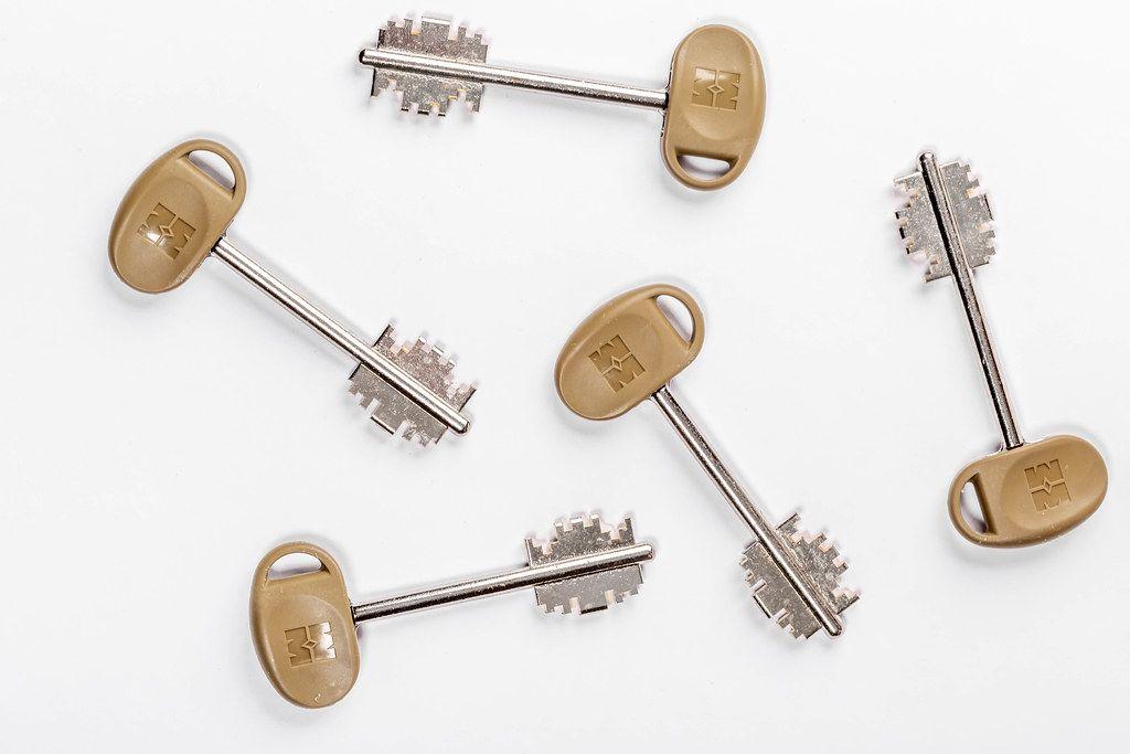 Metal keys on white background
