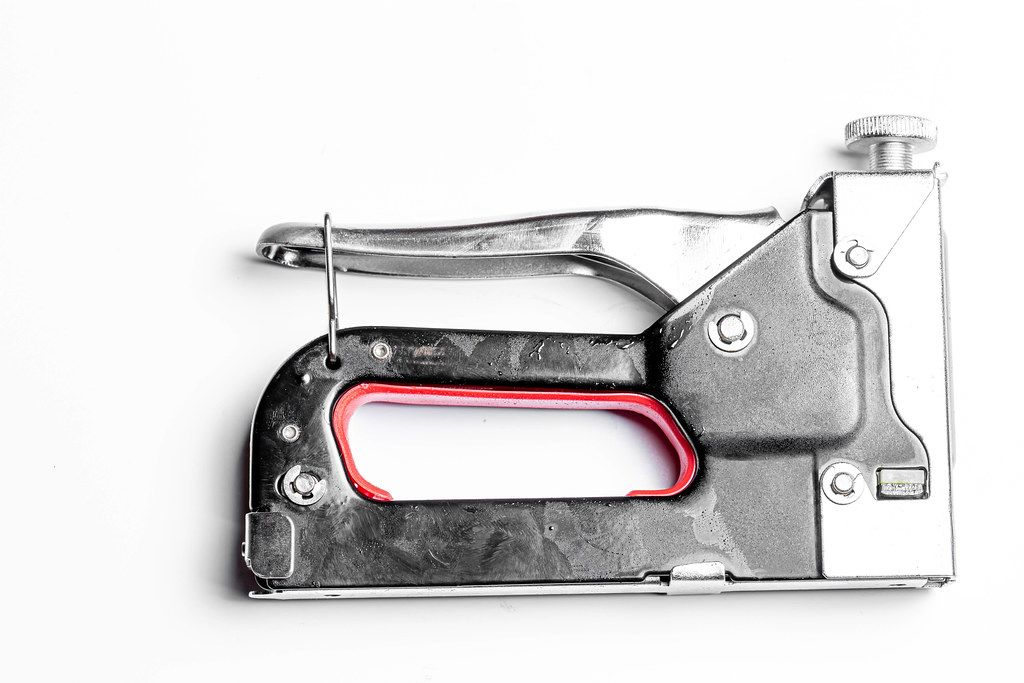 Metal manual stapler on a white background