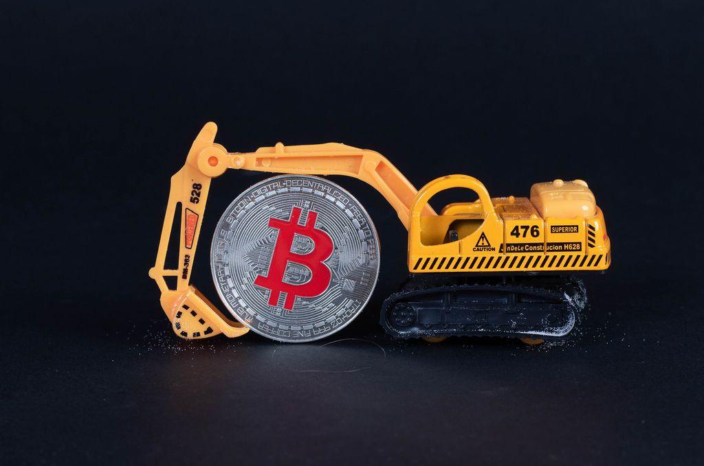 Miniature excavator with Bitcoin