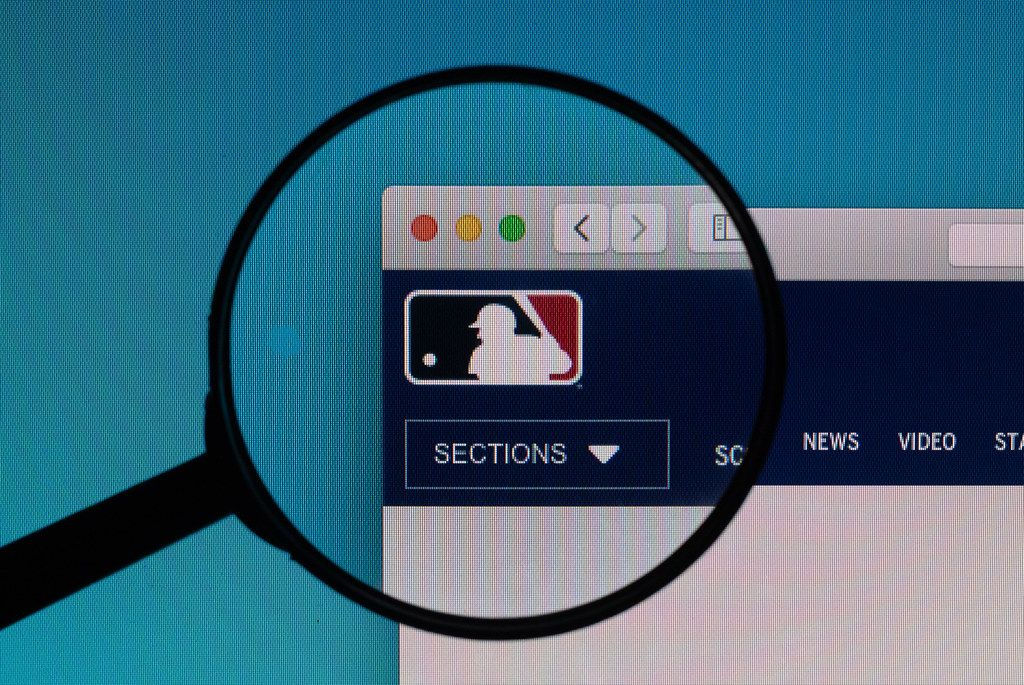 MLB.com logo under magnifying glass