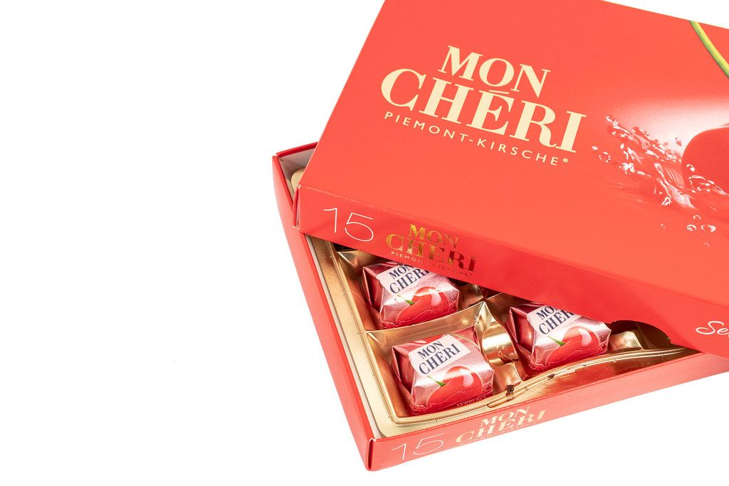 Mon Cheri Chocolate with copy space above white background