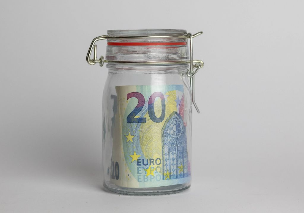 Money jar containing 20 Euros