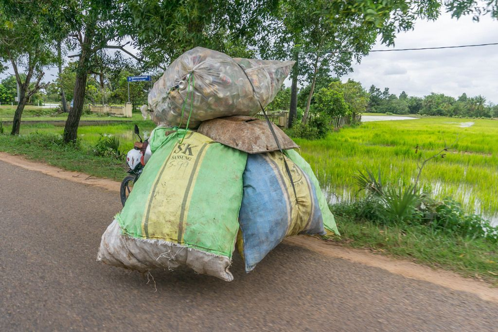 Motorbike carrying Big Bags of Trash in Siem Reap, Cambodia